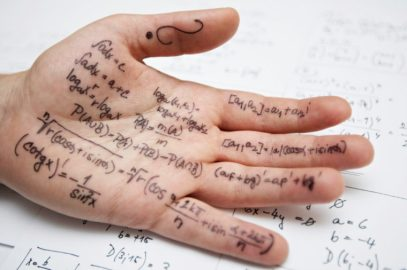 Close-up of a hand covered in formulas for a math class exam
